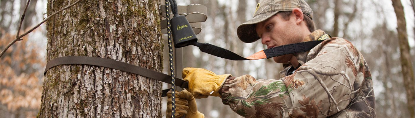 Deer hunter practicing treestand safety with the use of a Hunters Safety System harness and lifeline