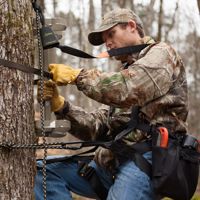 Deer hunter practicing treestand safety with an HSS harness and lifeline